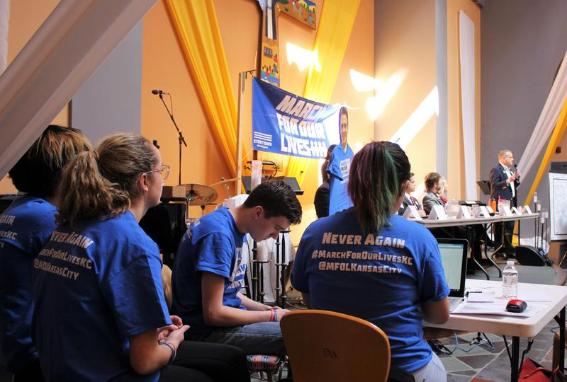 Four high schoolers from Johnson County run a 'fact-checking' table during a town hall in Olathe, Kansas, inspired by the recent 'March for Our Lives' rally in Kansas City, Missouri.