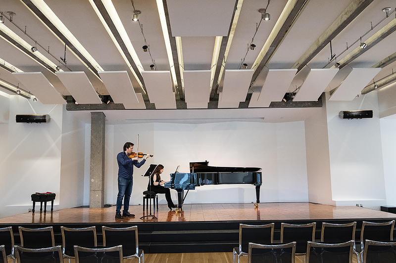Violinist David Radzynski and pianist Lolita Lisovskaya-Sayevich rehearse in the Parkway Room, one of two performance halls in the 1900 Building.