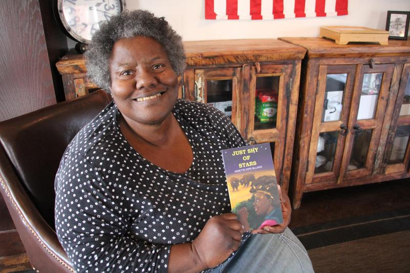 Poet Annette Billings with her newest poetry collection.