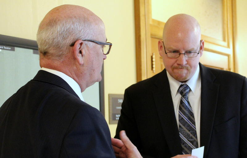 Kansas Medicaid Director Jon Hamdorf, right, talks with House Minority Leader Jim Ward in the Statehouse.  Hamdorf is the administration's point person on KanCare 2.0, which would add a work requirement for Medicaid recipients. Ward opposes the plan.