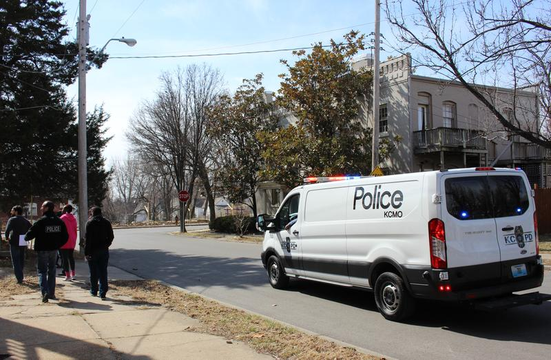 Kansas City police canvas a block on March 10, 2018 in the Northeast neighborhood. Police officials say they are hoping to get more tips in homicides and other crimes by forging better relationships with community members.
