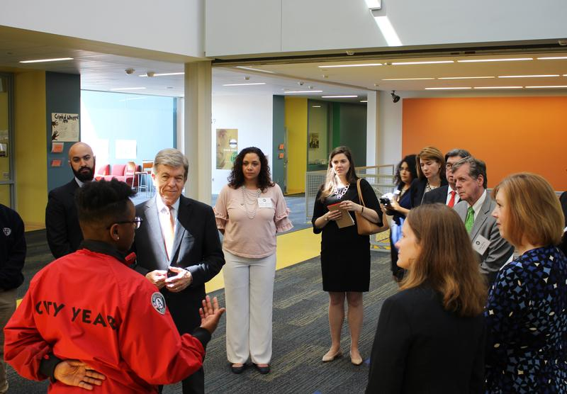 City Year member Christeen Walker shares her story with U.S. Senator Roy Blunt Monday at the Ewing Marion Kauffman School.