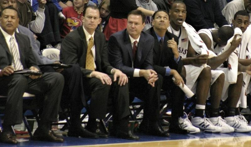 Neither head coach Bill Self, center, nor any University of Kansas coach or staff member has been accused of any wrongdoing, though Kansas Athletics is in the midst of a contract extension with Adidas.