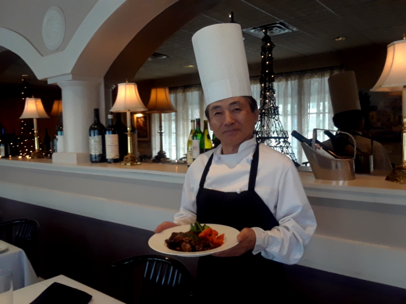 Tatsuya (Tatsu) Arai presents the classic French dish beef Bourguignon in his restaurant in Prairie Village in the suburbs of Kansas City.