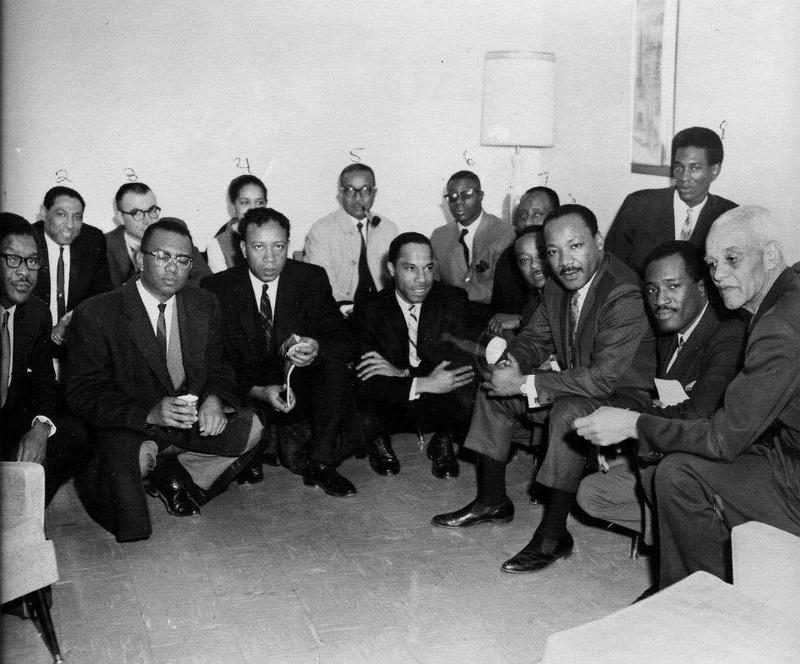 Martin Luther King Jr. poses for a photo in January 1968. Chester Owens Jr. is in front, third from left. Kansas state Sen. George Haley, the first black senator in Kansas, is in front, fourth from left. Bob Hughes Jr. is in the back, fifth from left.