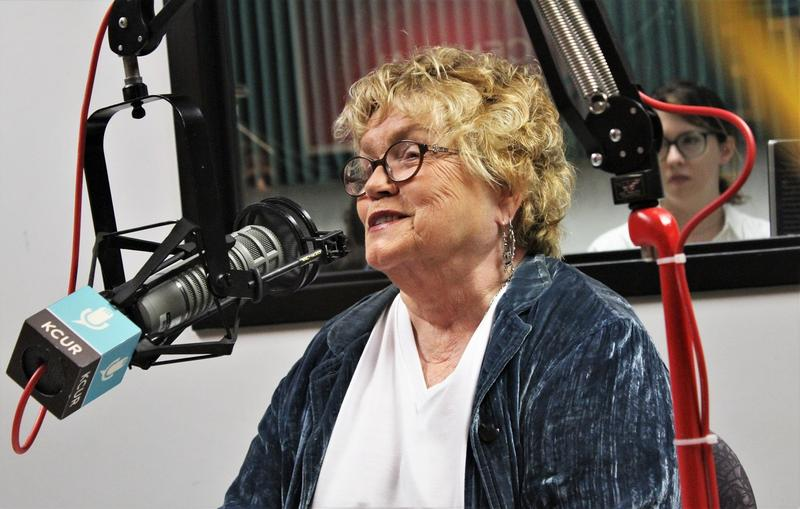 Donna Moore seated in front of a microphone in the KCUR studio