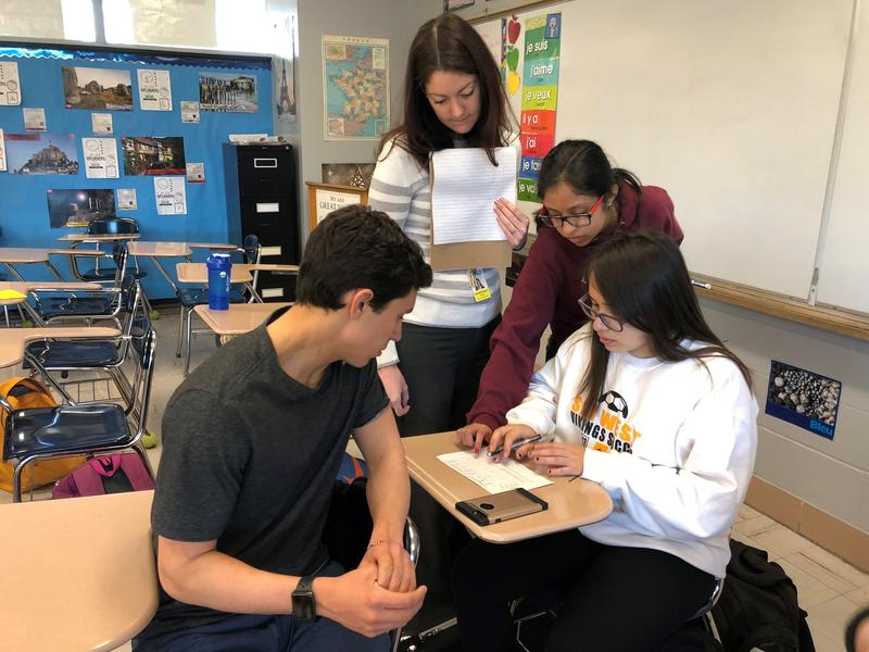 Shawnee Mission West French teacher Katie Bogart works with a small group of students working on vocabulary.