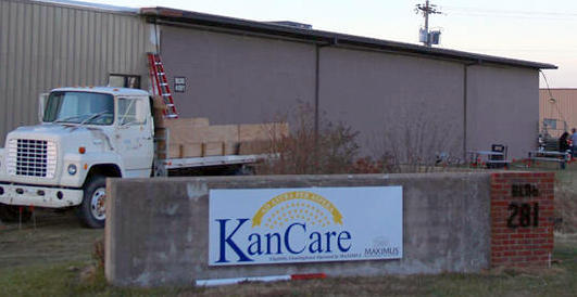 Applications for Medicaid coverage in Kansas have been stuck in a chronic backlog. The contractor processing those records is under pressure to fix the problems.