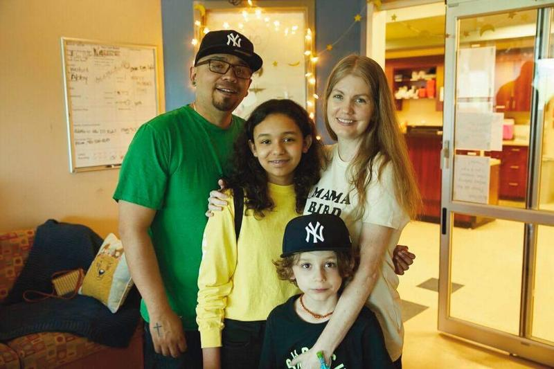 Kari Alejandre in her room in the cardiac intensive care unit with her husband Adolfo, daughter Bella, and son Paolo.
