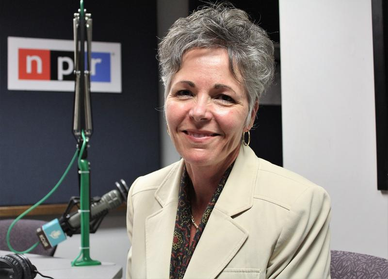 A picture of a women with gray hair in KCUR studio. Subject visable from chest up.