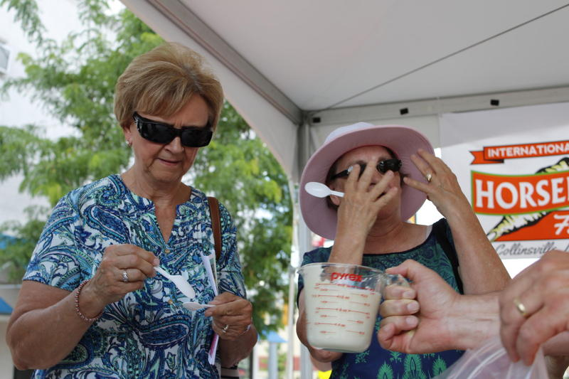 Two taste-testers feel the burn after eating freshly blended horseradish at the festival in Collinsville, Illinois.