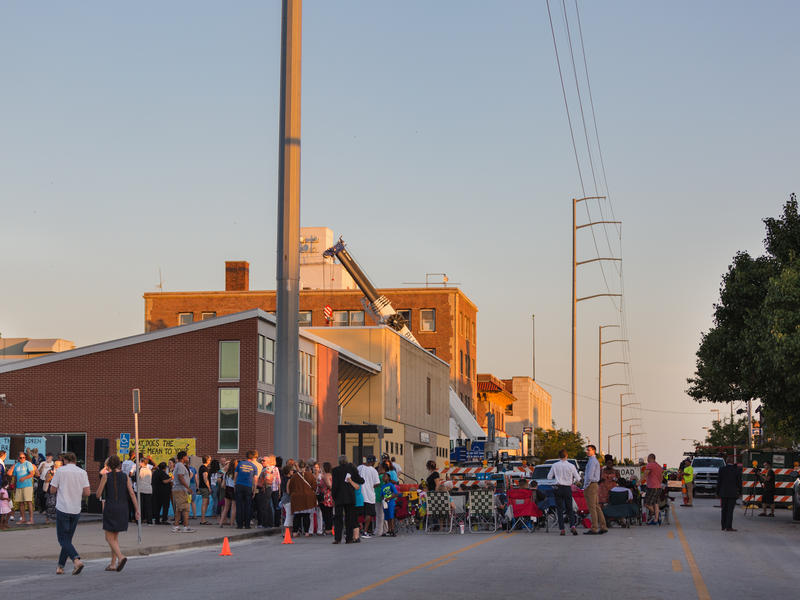 People gather for the installment of a bridge spanning Kansas City's Troost Avenue. The bridge connects the current Operation Breakthrough campus on the east side of Troost to the newly-acquired western building.