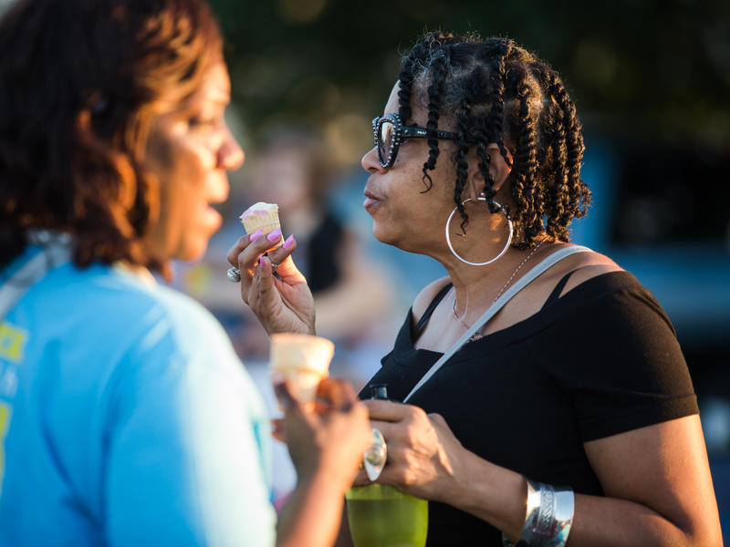 Sheila Davis enjoys ice cream at the Operation Breakthrough bridge-raising. Davis has worked in finance and been a program specialist at Operation Breakthrough for 31 years.