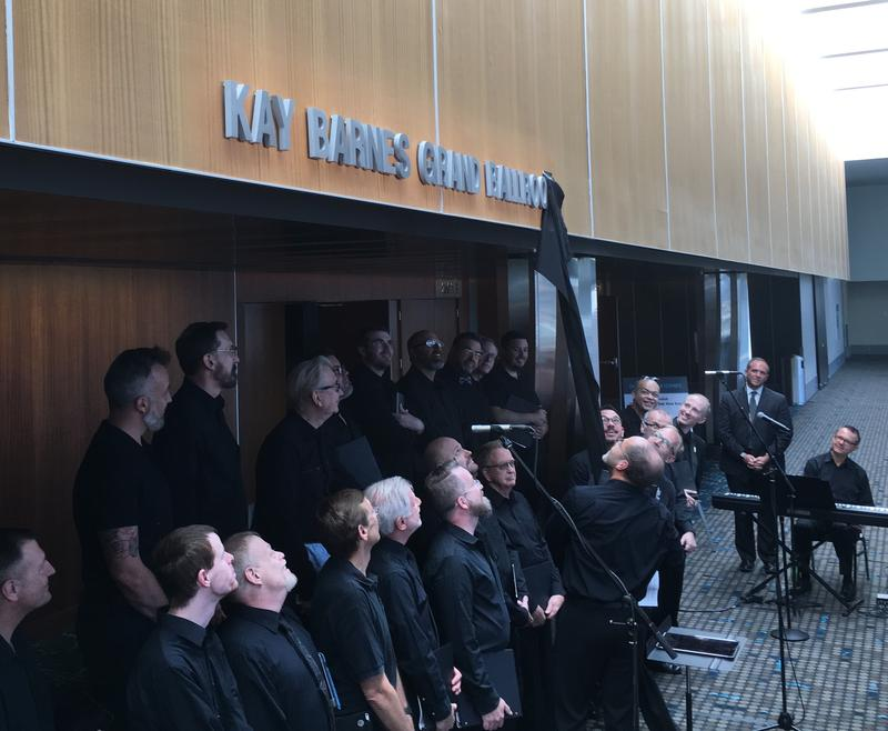 Members of the Heartland Men's Chorus unveil the new name of the Grand Ballroom at the Kansas City Convention Center.