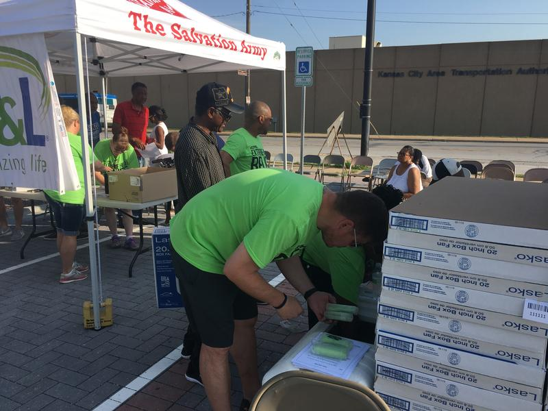 Volunteers from The Salvation Army and employees from Kansas City Power and Light handed out box fans, heat rags and bottled water.