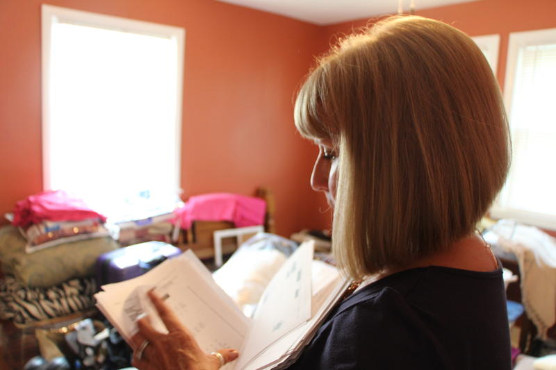 Judy Conway pages through records on her grandson, Adrian Jones, from the state child welfare agency. Conway waited more than a year after her grandson's death from abuse to get 2,000 redacted pages from the Kansas Department for Children and Families.