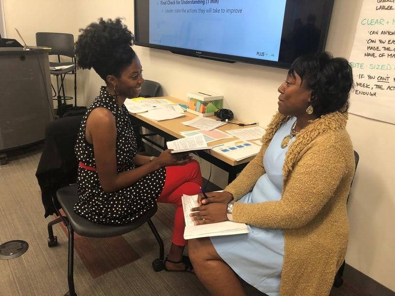 Asha Moore, left, and Tawana Hughes are part of KC PLUS, which is partnering with UMKC to prepare urban principals. The program kicks off with an intensive four-week summer course, followed by a two-year 'residency' working under experienced leaders.