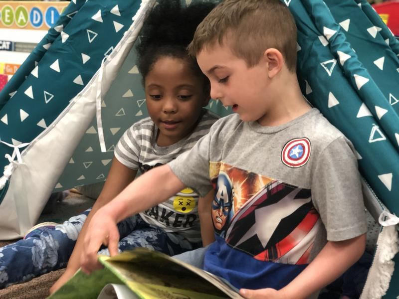 Students in Julia Meyer's kindergarten class at Pitcher Elementary practice reading to each other.