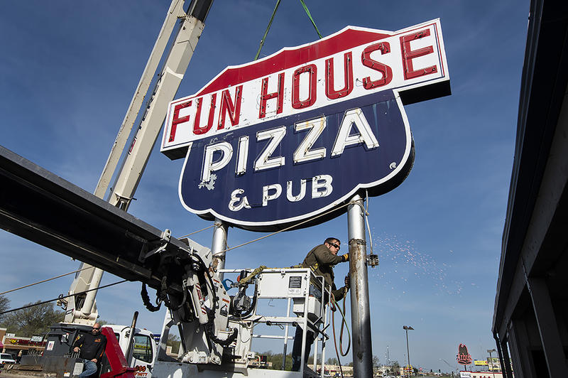 After 50 years of beckoning drivers on 350 Highway, the Fun House Pizza and Pub sign came down in April. It's going into storage with 15 other signs for eventual display in the Lumi Neon Museum.