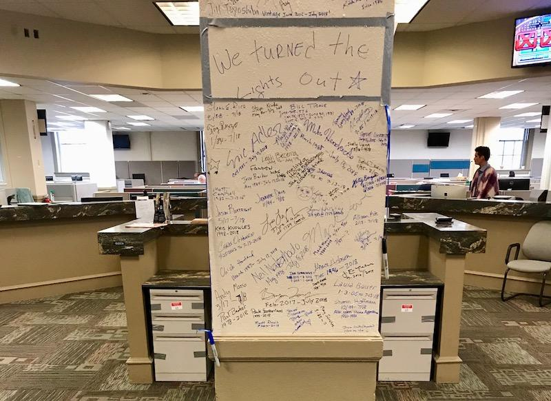 Reporters and editors penned their good-byes on this post in the middle of the old newsroom.