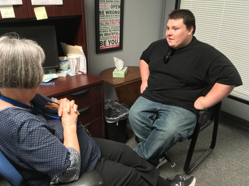 Cody Goodwin sits down for a session with his counselor, Mary Bitterman, at a ReDiscover clinic in Kansas City.