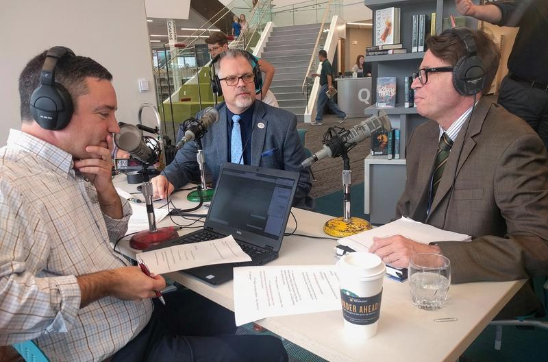 Steve Potter, center, and Sean Casserly, right, joined Up To Date guest host Brian Ellison in a live broadcast from Johnson County's new Monticello library branch.