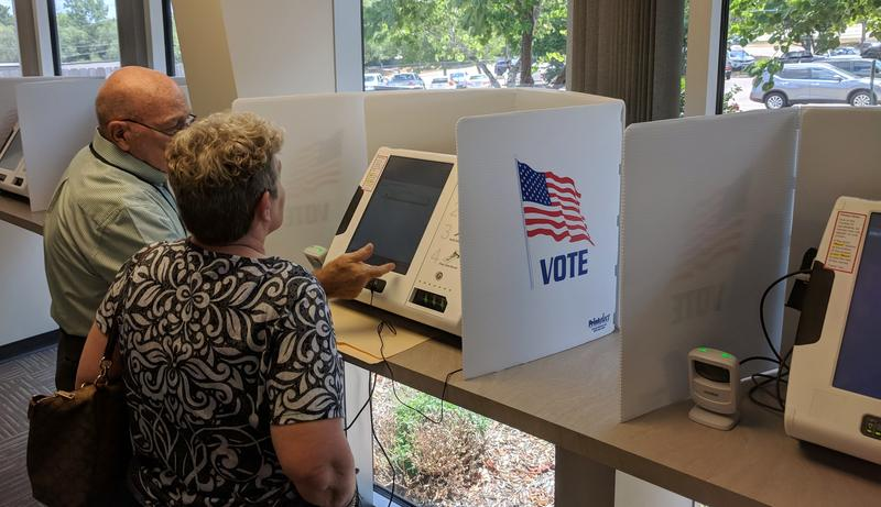A 'backend coding issue' is to blame for the long delay in processing election results in the Johnson County primaries, according to the equipment company.
