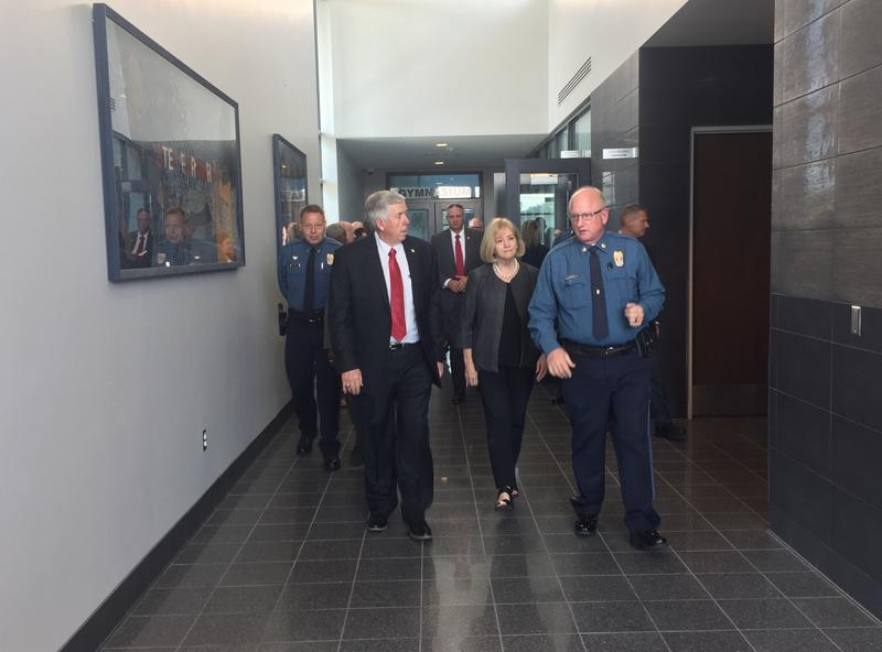 Missouri Gov. Mike Parson (left) toured Kansas City East Patrol police station and crime lab with Maj. Gregory Volker (right) and St. Louis Mayor Lyda Krewson on Thursday during a daylong visit to Kansas City.
