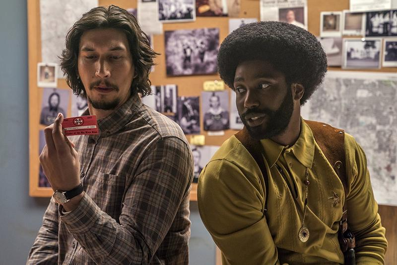 Adam Driver (left) and John David Washington as two police officers who infiltrate the Ku Klux Klan in the 1970s in the film 'BlacKkKlansman.'