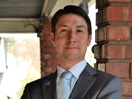 Matthew Merryman's campaign is focusing on the environmental attorney's pledges to ensure safe and successful schools, develop a regional green transportation policy, and solve the county's detention center woes.