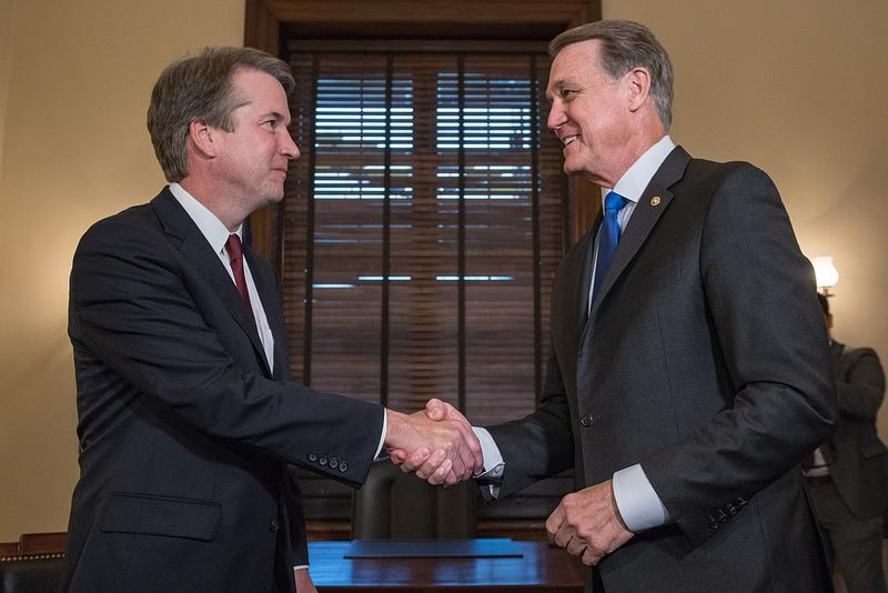 Supreme Court nominee Brett Kavanaugh (left) with Senator David Perdue.