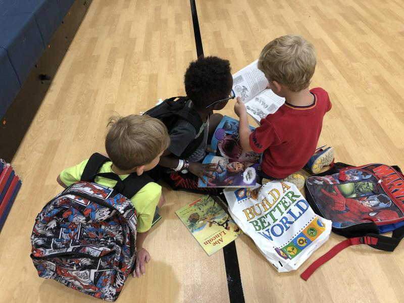 Olathe students read books from the Olathe Public Library during summer school.