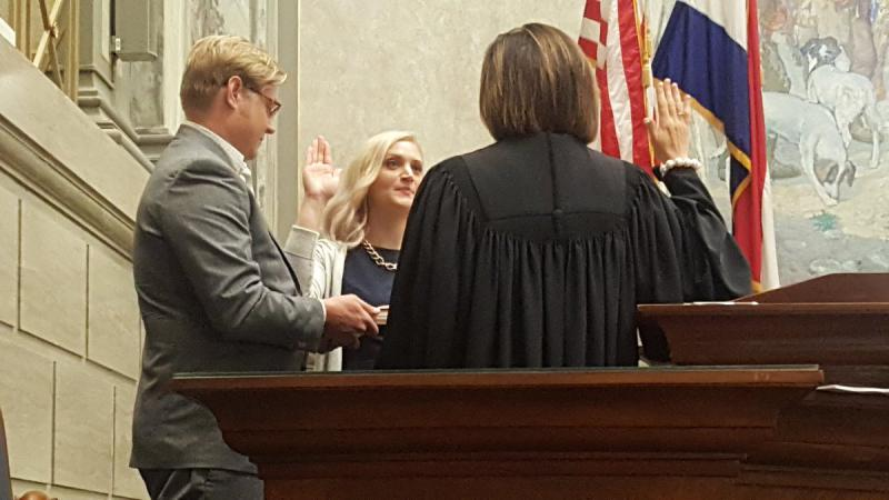 Lauren Arthur takes the oath of office for the 17th District Senate seat on Wednesday in Jefferson City.