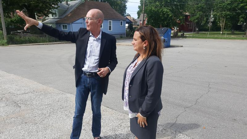 SAVE, Inc., CEO Blaine Proctor (left) and Heather Bradley-Geary, the director of supportive housing for Vecino Group, look at site of potential development in Kansas City.