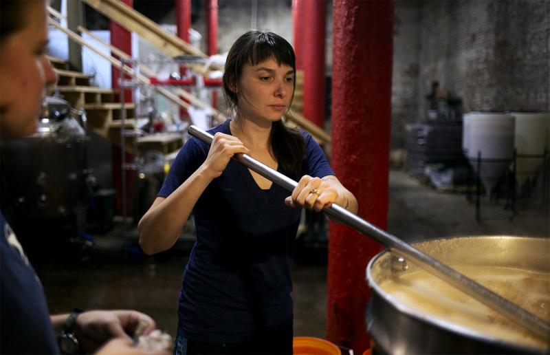 Earthbound Beer co-owner Rebecca Schranz brews beer in the micro-brewery's basement.