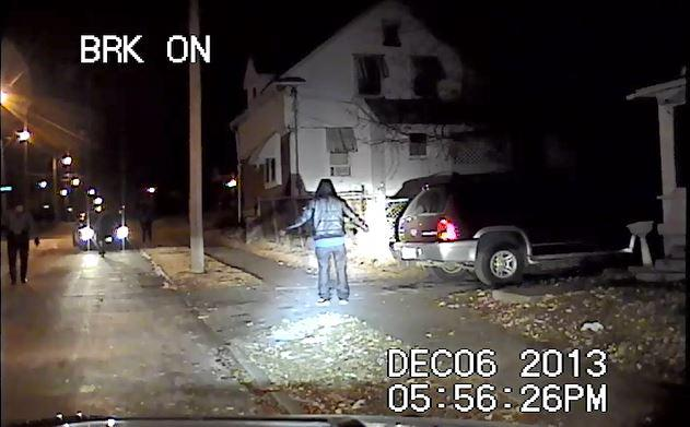 A dash cam video from 2013 shows Joshua Bills standing still with empty hands extended outward as five Kansas City police officers approach. The ACLU is suing one officer for excessive force against Bills.