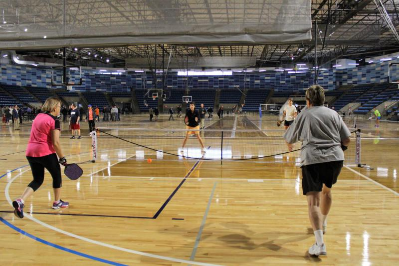 Pickleball players took to the courts at Hy-Vee Arena on Friday.