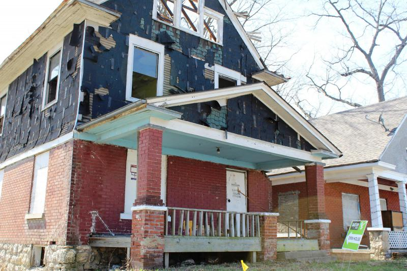 An initiative to revitalize Kansas City's east side would, among other things, create a fund to rehabilitate dangerous homes, like this one, pictured in 2016. A city council committee advanced it, although neighbors remain skeptical.