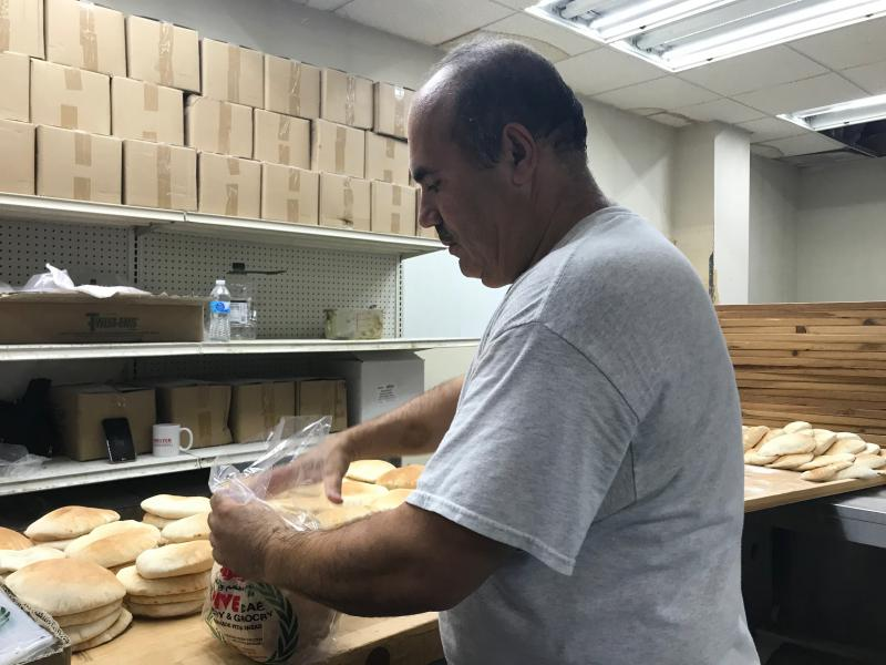 Salah Mansi, the owner of Olive Cafe in Kansas City, has been making fresh pita bread for the last 15 years.