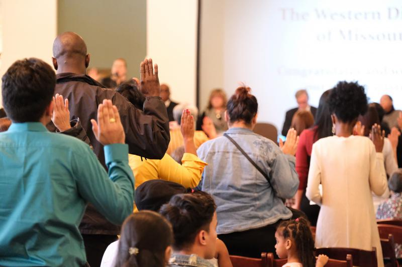Almost 50 new Americans took the Oath of Allegiance during a naturalization cermoney Wednesday, Nov. 7, 2018 at the downtown Kansas City library.