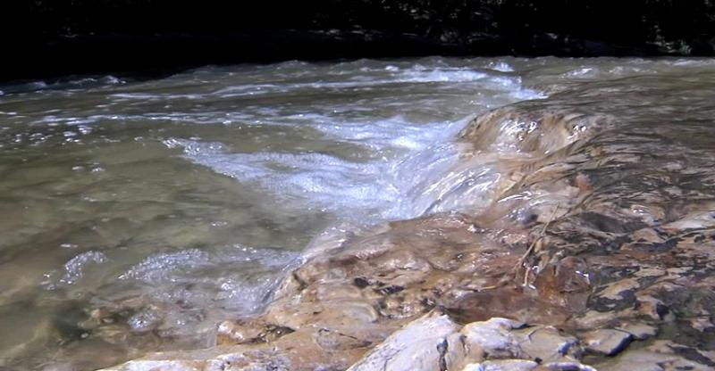 Flash flood waters of Indian Creek were  lower than Sunday  when Jeffrey Bridge disappeared.