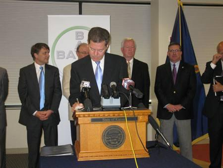 Gov. Brownback signs an order creating an NBAF steering committee in Kansas.