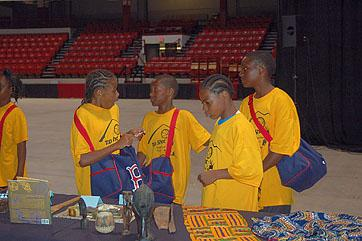 Students from a local community group in Boston peruse the traveling exhibits