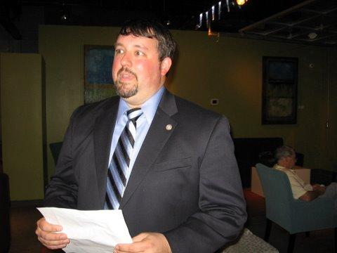 Jon Hile holds election tally results giving him a seat on the Kansas City  Board of Education.
