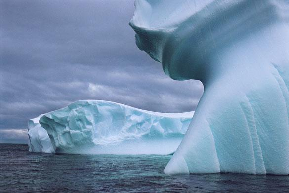 Icebergs shaped by water and wind in Antarctica: Antarctica holds about 90% of the earth's ice and scientists now believe that the Antarctic Peninsula is melting faster than previously thought