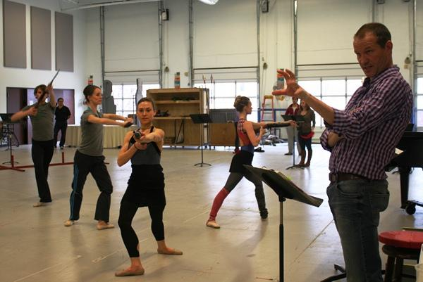 "Scenes from a rehearsal: Kansas City Ballet dancers rehearse the revolutionary ballet in ""Nixon in China."" Director Michael Cavanagh, pictured at right."