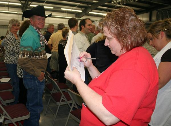 Votes are tallying as people stand to vote for the Tea Party slate of candidates.