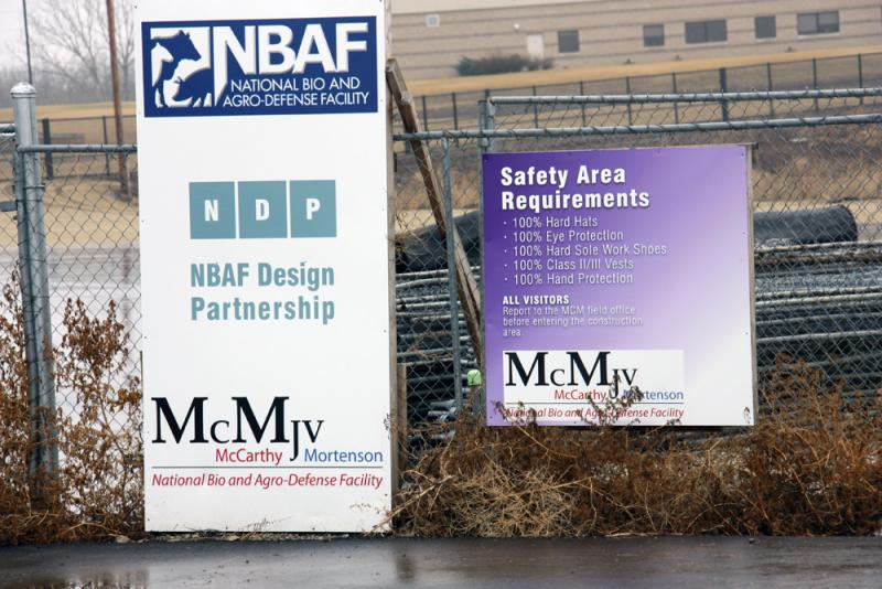 Signs outside the NBAF site in Manhattan, Kan.