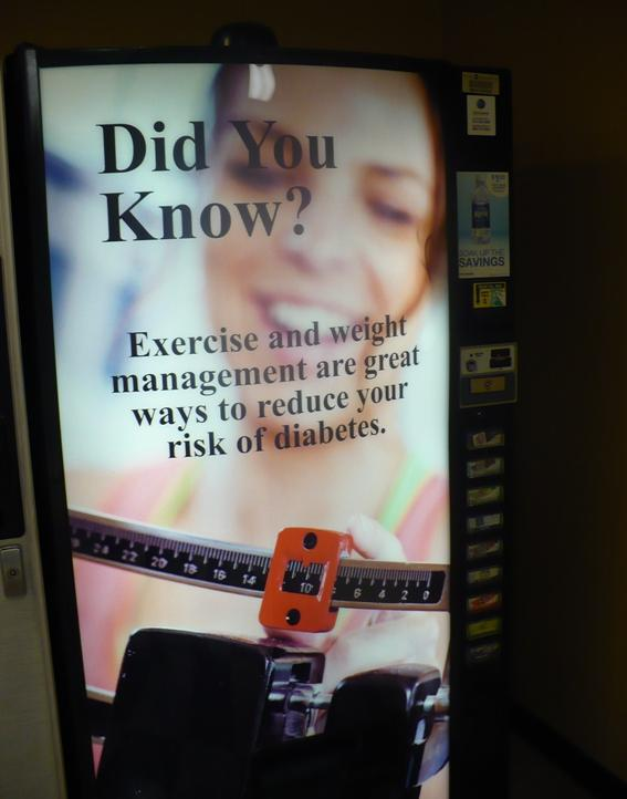 The hospital has posted wellness tips around the hospital, including on this vending machine.