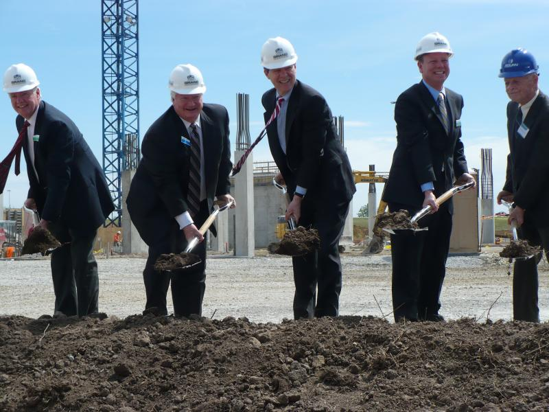 Cerner leaders, public officials broke ground Tuesday at the company's new campus. Pictured from left to right: Rory O'Connor of Grand Construction; Cerner Co-founder Cliff Illig; Kansas Governor Sam Brownback; Joe Reardon, mayor of Wyandotte County